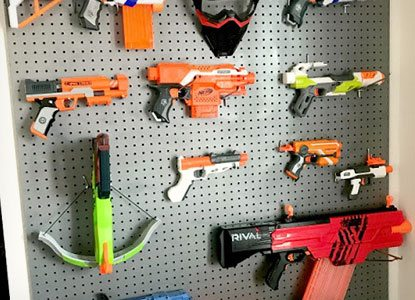 Cute way to display all those toy guns on the wall!